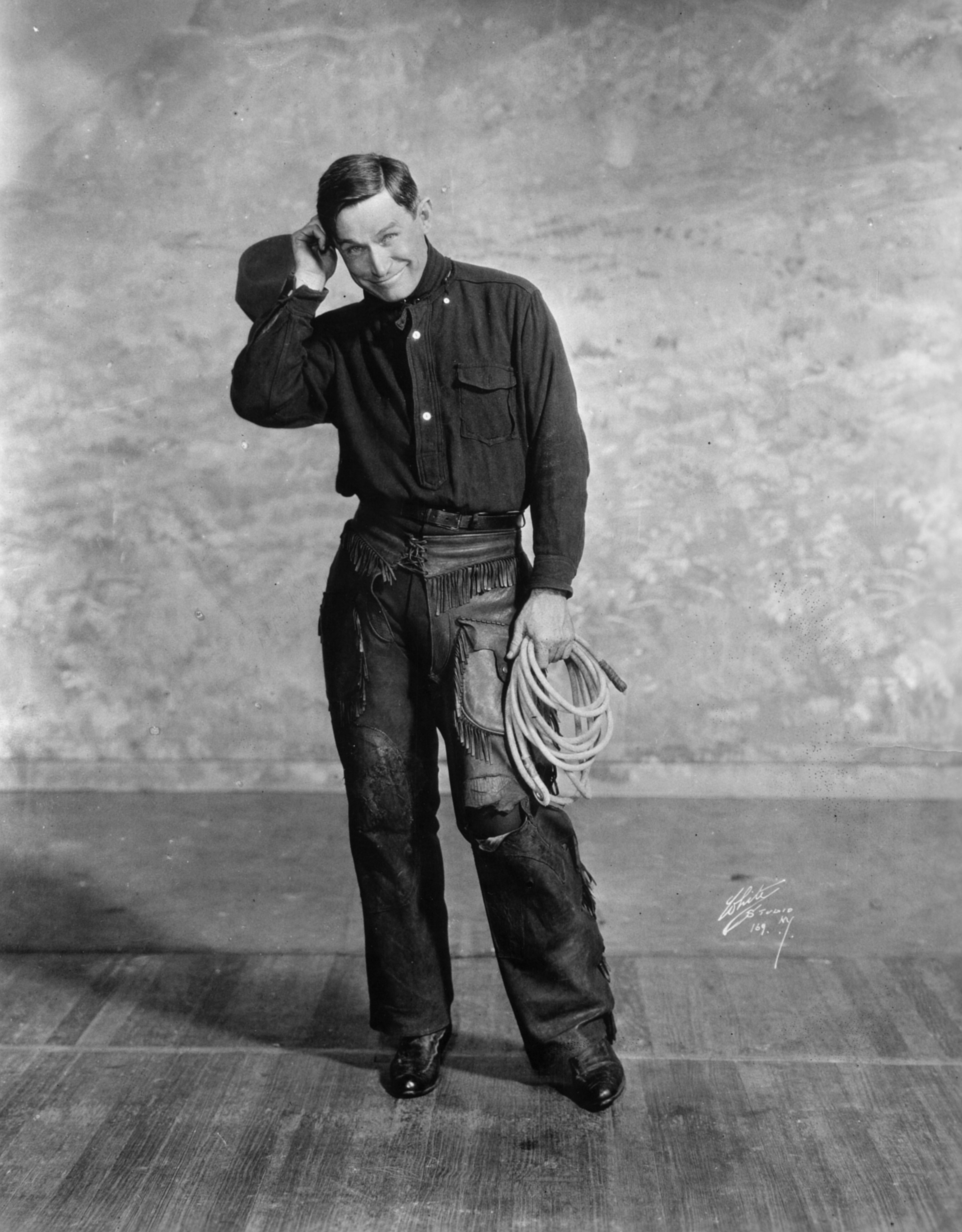 Will Rogers in famous vaudeville promotional photo.